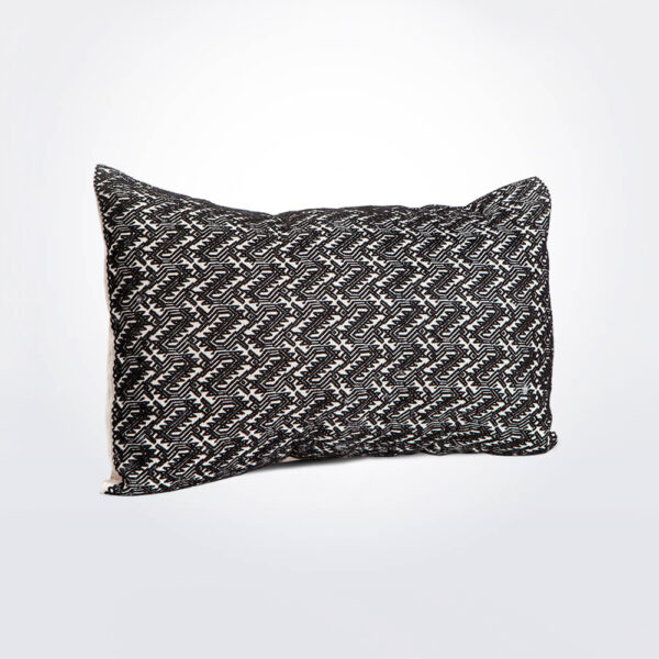 Black and little white pillow cover product photo.