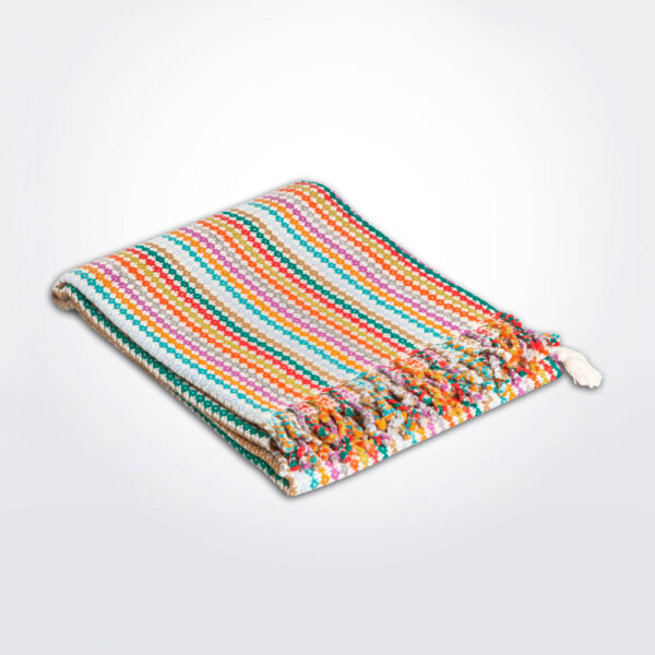 Multicolor baby alpaca throw gray background.