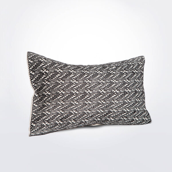 White and black pillow cover.
