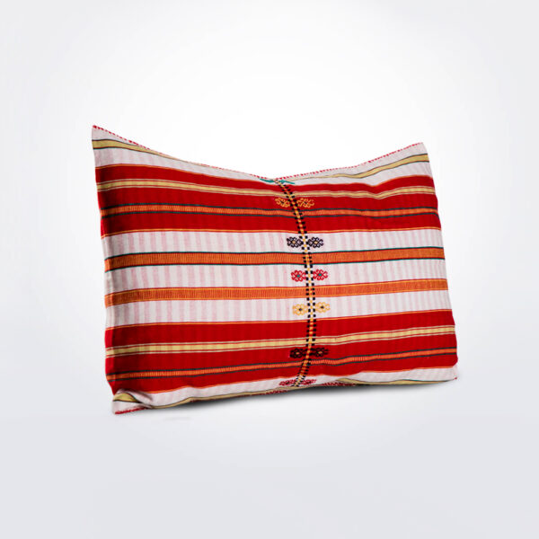 Red patterned pillow cover.