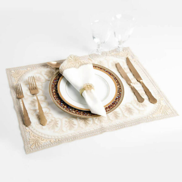 Italian embroidered gold placemats with tablesetting.