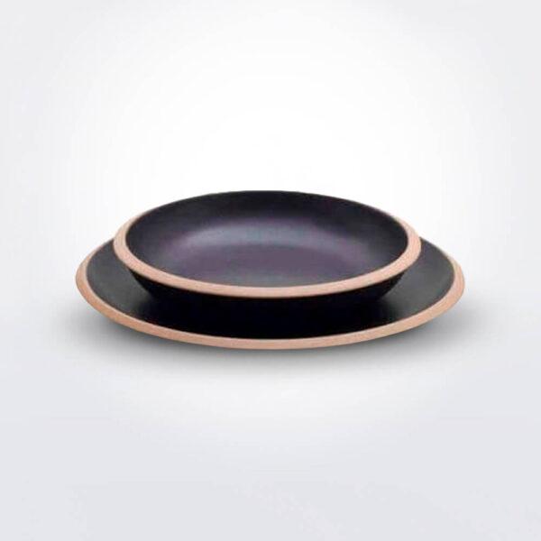 Stoneware plate set gray background.