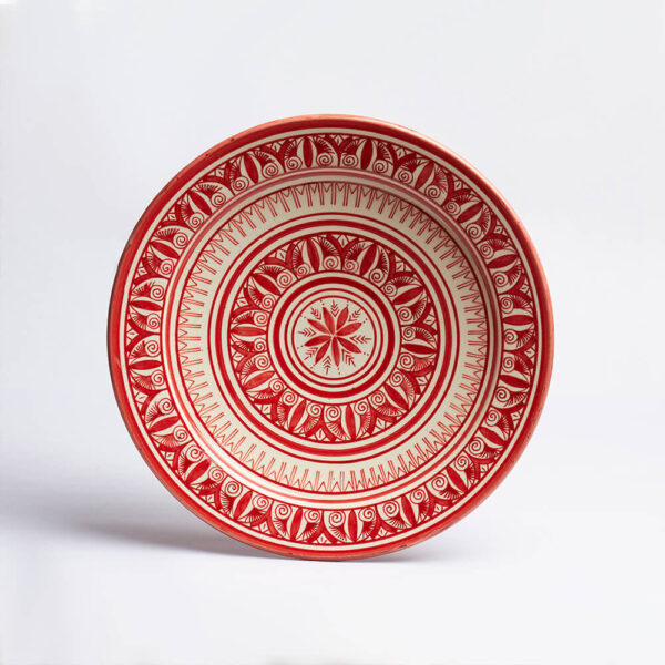 Moroccan Safi red platter with gray background.