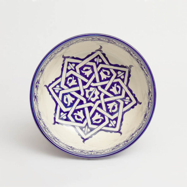Moroccan blue salad bowl with grey background.