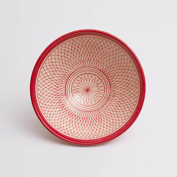 Moroccan Safi red salad bowl with grey background.