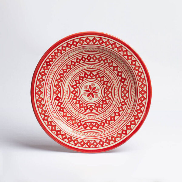 Moroccan Safi red platter with grey background.