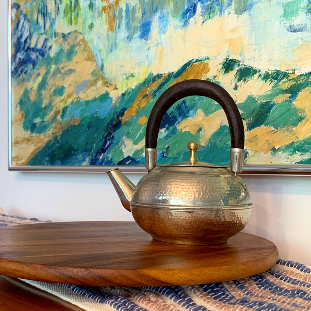 Moroccan -silver-hammered-teapot-on-a-table