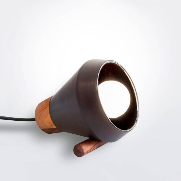 Ceramic and wood black desk lamp.