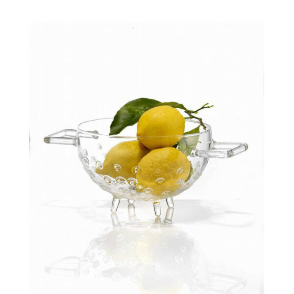 Glass fruit colander with lemons.
