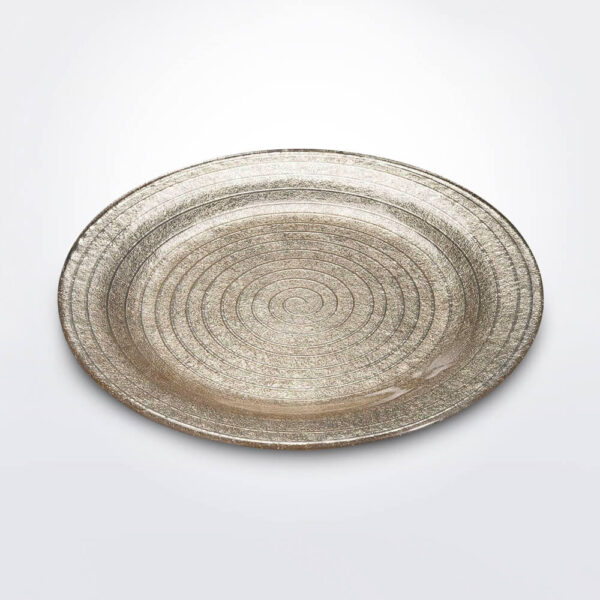 Spiral sand charger plate gray background.