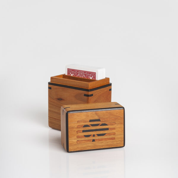 Light wood playing cards holder opened.