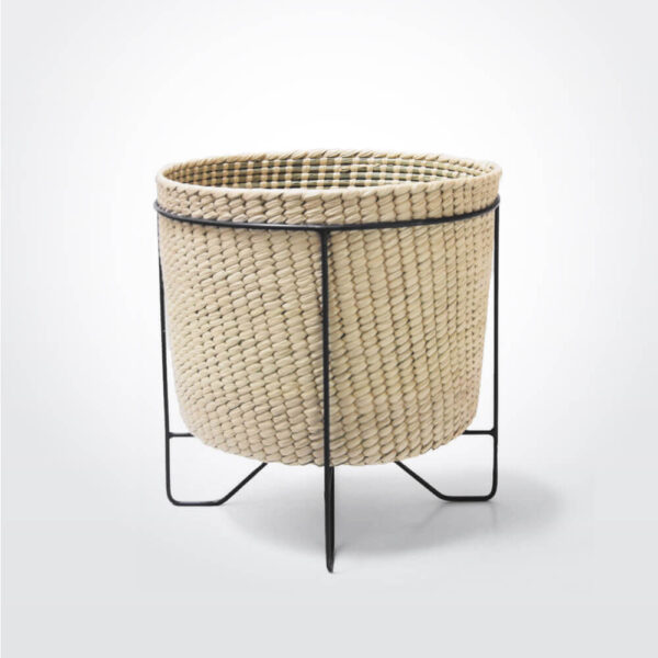 Palm leaf basket with black stand large product photo.