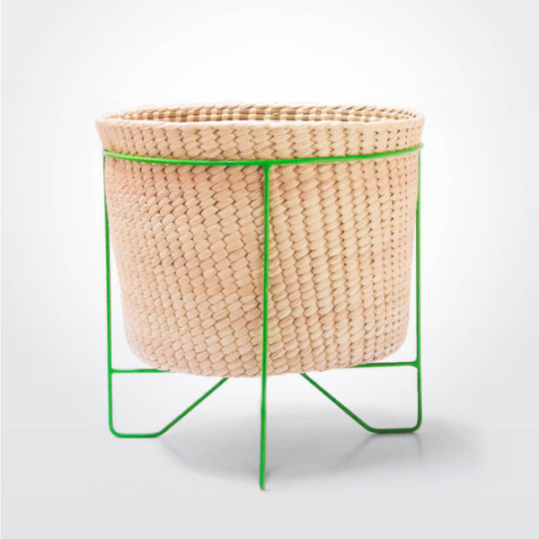 Palm leaf basket with green stand large gray background.