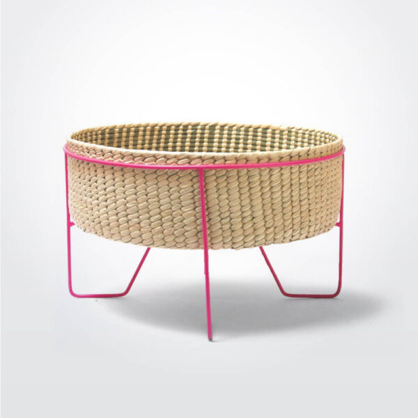 Palm leaf basket with pink stand small gray background.