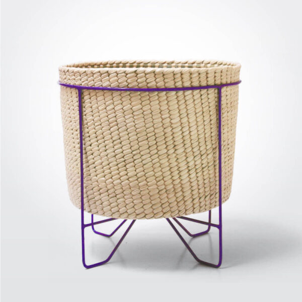Palm leaf basket with purple stand large gray background.