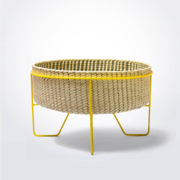 Palm leaf basket with yellow stand medium gray background.