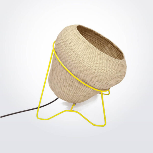 Palm leaf lamp with yellow stand.