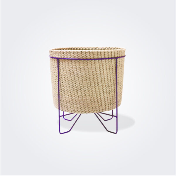Palm leaf basket with purple stand small gray background.