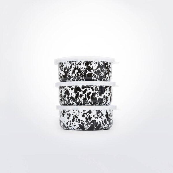 Black and white enamel storage set gray background.