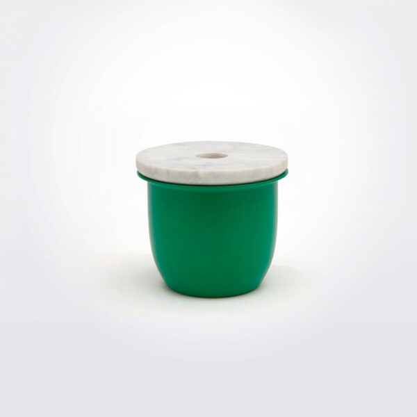 Green metal container with marble lid.
