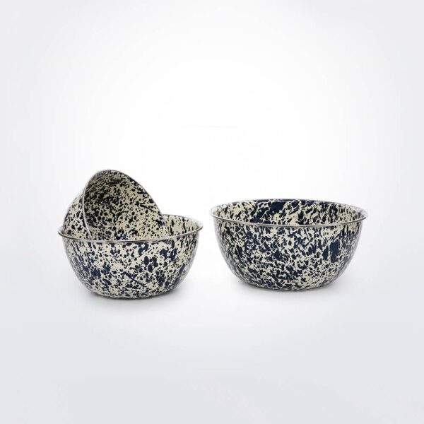 Navy splatter mixing bowl set gray background.