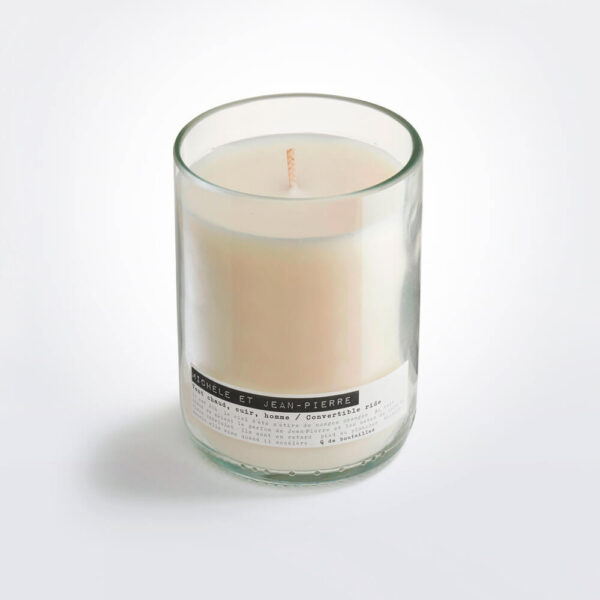 Wine bottle convertible ride candle gray background.
