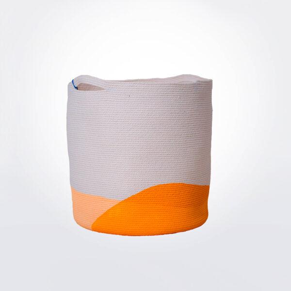 Marigold laundry basket gray background.