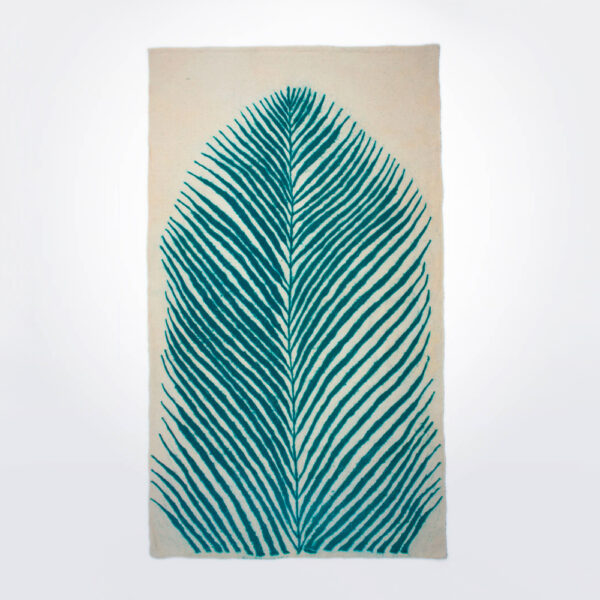 Natural and turquoise leaf wool rug product picture.