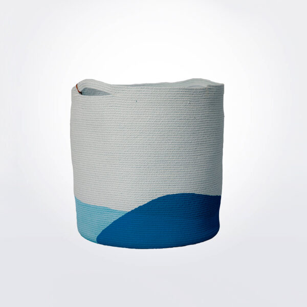 Ocean blue laundry basket gray background.