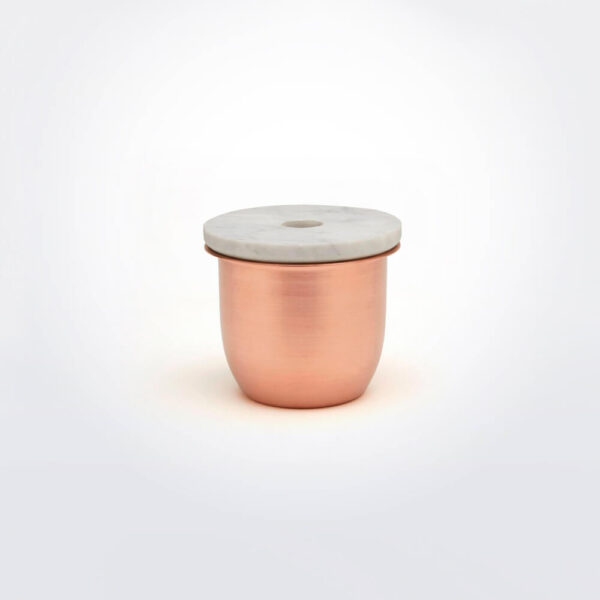 Copper metal and marble container gray background.