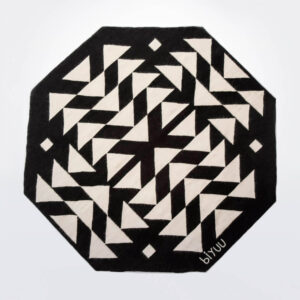 Black and white wool rug product picture.
