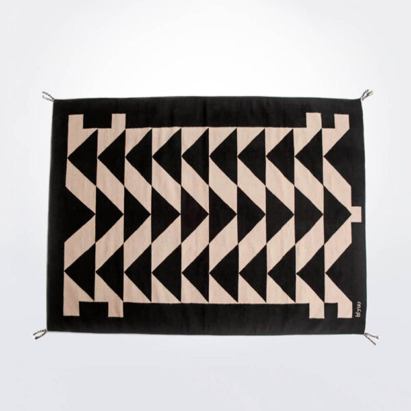 Black patterned wool rug.