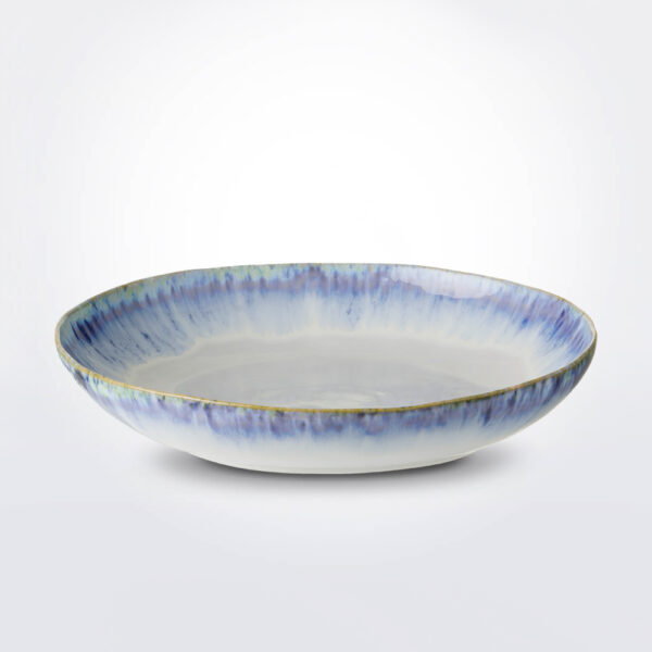 Brisa serving bowl with grey background.