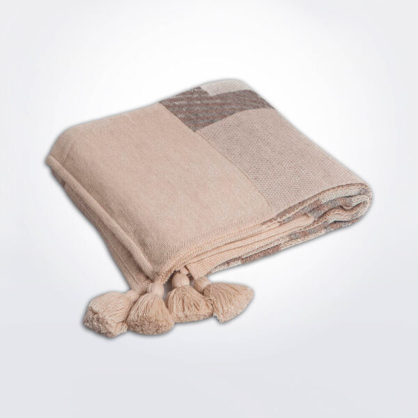 Beige ethnic alpaca throw gray background.