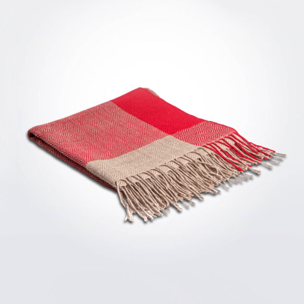 Red alpaca cape gray background.