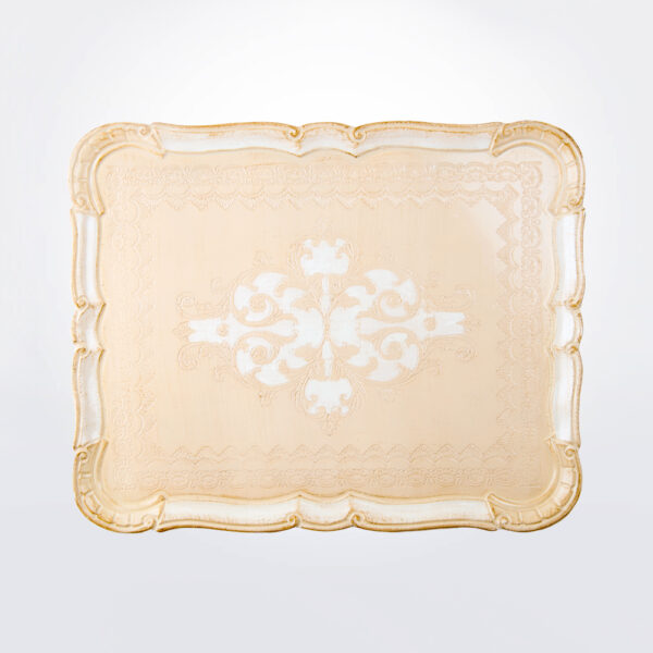 Wooden cream hues tray on gray background.