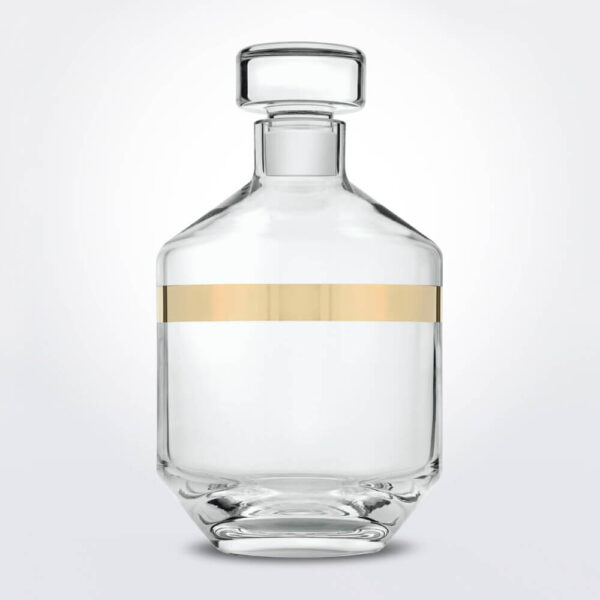 Clear & gold liquor glass bottle product photo.