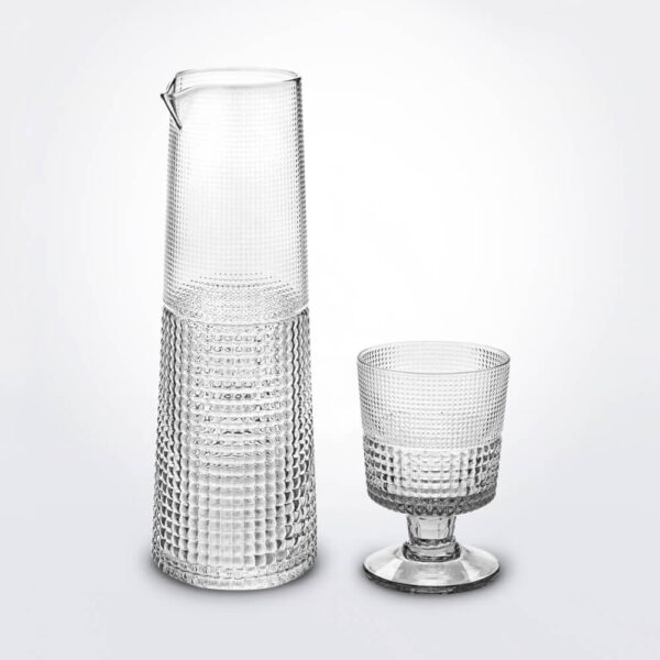 Glass cup and carafe set.