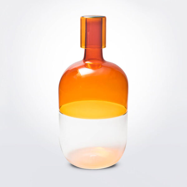 Oval amber bottle.