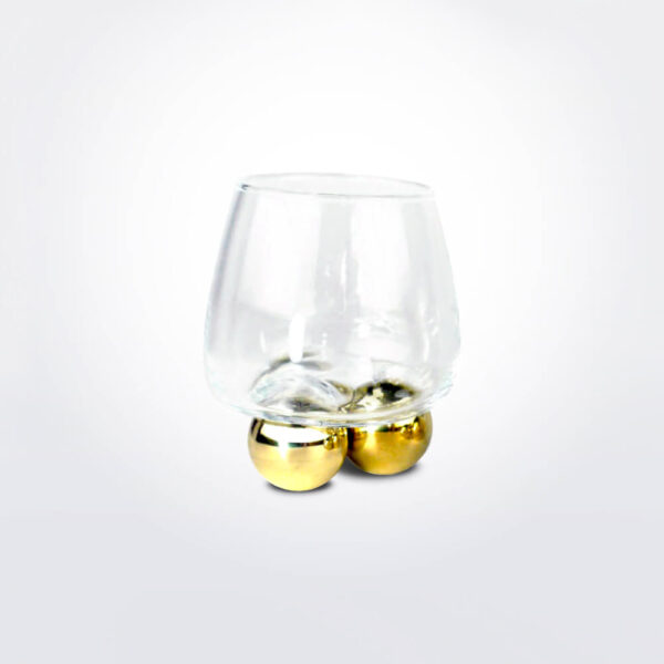 Whiskey glass ball set grey background.