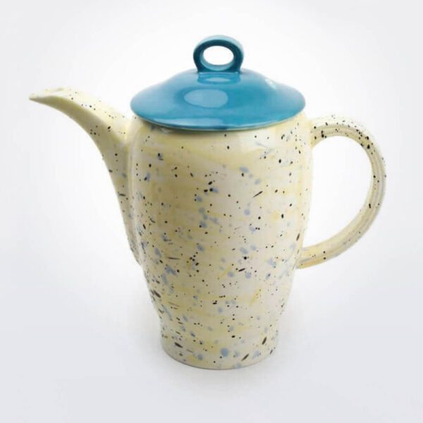 Ceramic teapot gray background.