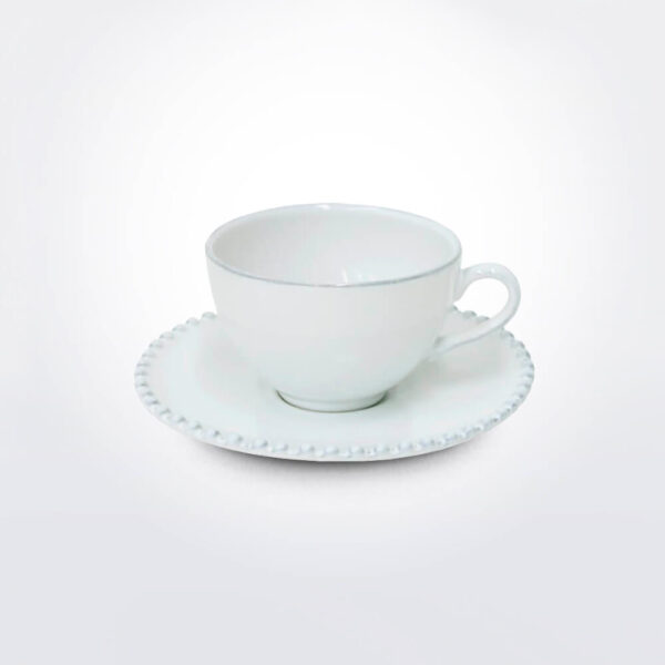 Costa Nova pearl coffee cup saucer set background.