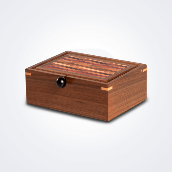 Small patterned wood box product picture.