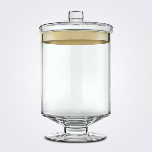 Clear and gold glass container long white background.
