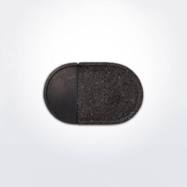 Oval lava rock platter with black background.