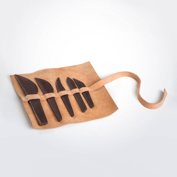 Wooden cutlery set with leather pack grey background.