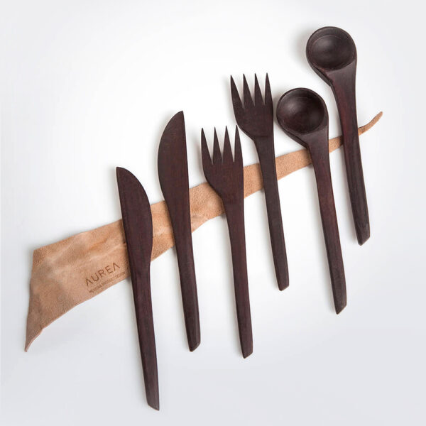 Wooden utensil set with grey background.