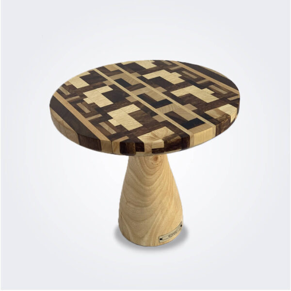 Patterned wood cake stand product picture.