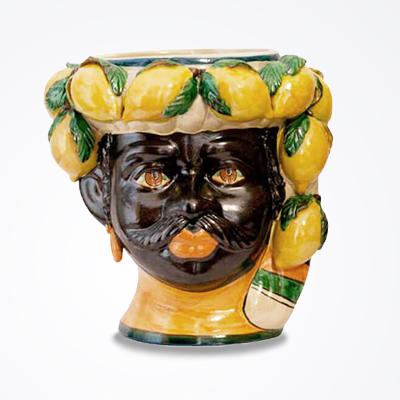 Lemon black man head vase product picture.