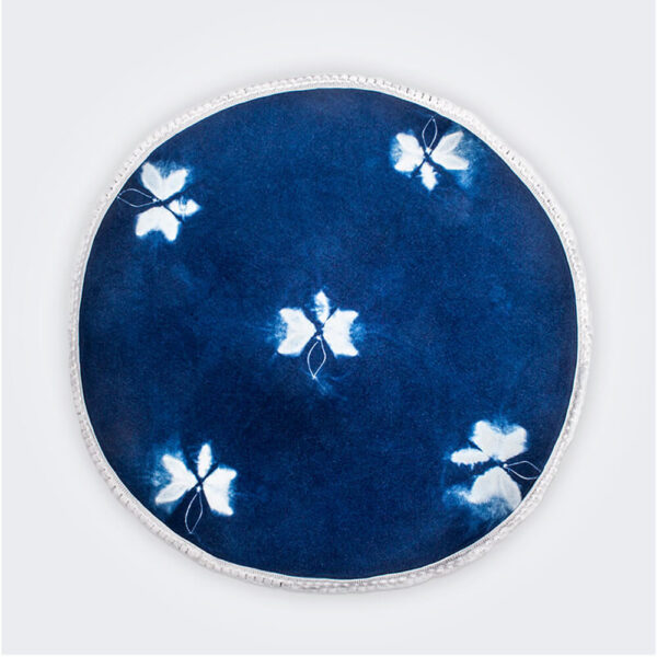 Indigo tie dye round placemat set product picture.